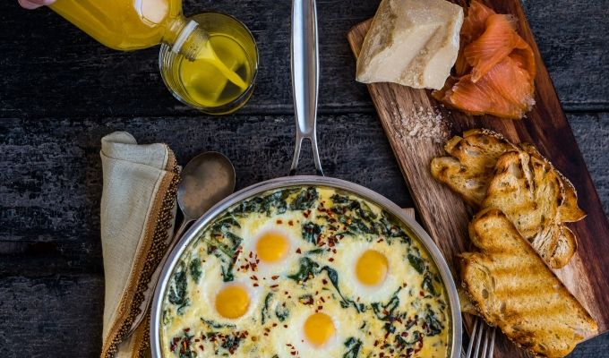 Baked Eggs in Ricotta Parmesan Creamed Spinach