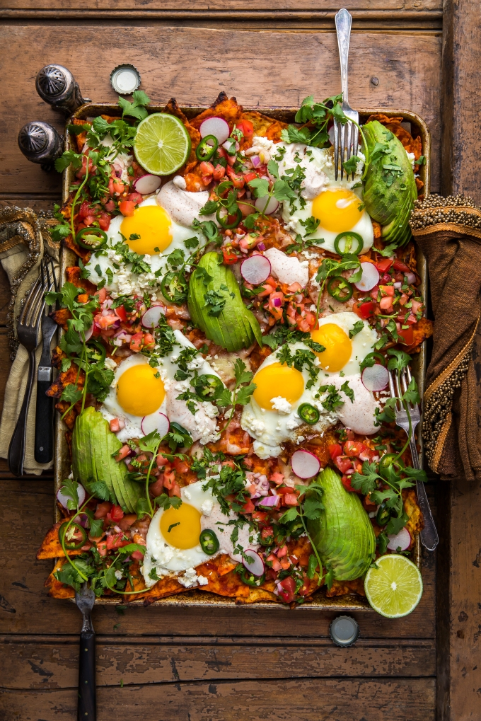 Loaded Red Chilaquiles with Fried Eggs, Fresh Pico, and Chili-Spiked Sour Cream