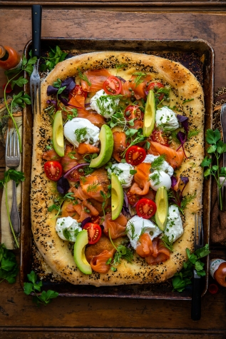 Salmon Salmon Breakfast Pizza with Poached Eggs, Avocado, & Whipped Goat Cheese